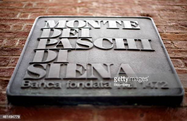 A logo sits on a sign outside a Banca Monte dei Paschi di Siena SpA bank branch in Siena Italy on Wednesday Jan 8 2014 Monte Paschi the bailed out...