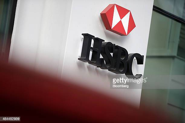 A logo sits on a sign outside a HSBC Holdings Plc bank branch in London UK on Monday Dec 9 2013 HSBC may sell a stake in its UK retail and commercial...