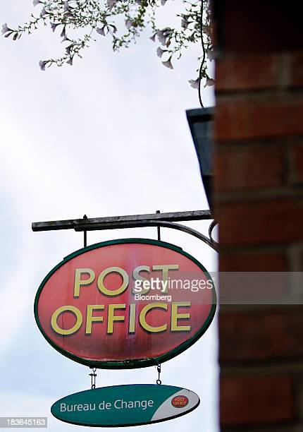 A logo sits on a sign outside a post office in Lymm UK on Tuesday Oct 8 2013 Royal Mail's initial public offering is significantly oversubscribed and...