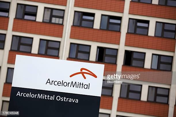 Logo sits on a sign outside the entrance to the ArcelorMittal steel plant in Ostrava, Czech Republic, on Monday, Aug. 26, 2013. ArcelorMittal, the...