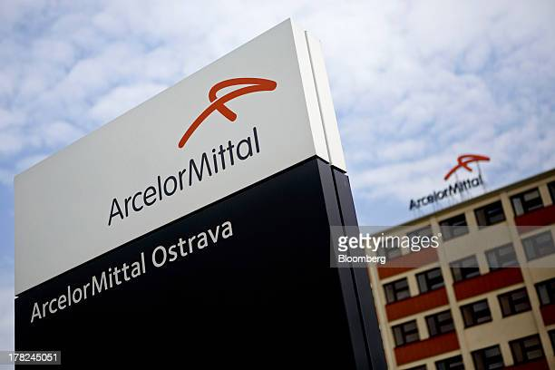 A logo sits on a sign outside the entrance to the ArcelorMittal steel plant in Ostrava Czech Republic on Monday Aug 26 2013 ArcelorMittal the world's...