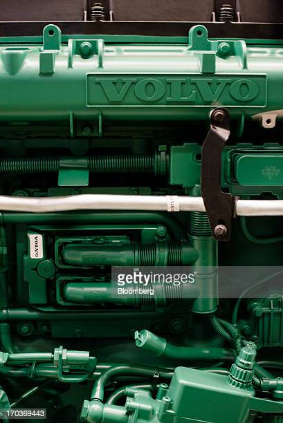 A logo sits on a truck engine during production at the Volvo AB manufacturing plant in Gothenburg Sweden on Tuesday June 11 2013 Volvo plans to...