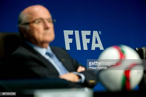 FIFA logo sits on a wall behind FIFA President Joseph S Blatter during a press conference at the end of the FIFA Executive Comitee meeting at the...