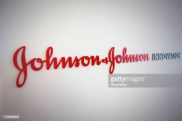 A logo sits on a wall inside Johnson Johnson's innovation centre in London UK on Thursday July 18 2013 Secondquarter sales rose 85 percent to $179...