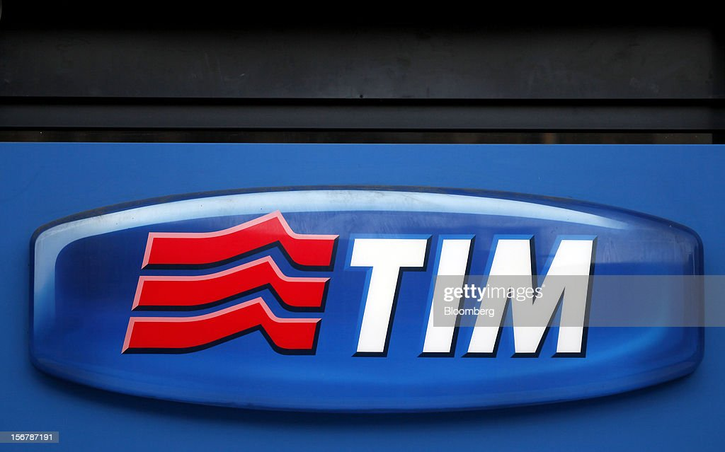 A logo sits on a wall outside a TIM store, the mobile unit of Telecom Italia SpA, in Milan, Italy, on Tuesday, Nov. 20, 2012. Telecom Italia SpA said it is still reviewing the possible spinoff of its fixed-line network and the company's board will discuss the outcome of its analysis on Dec. 6. Photographer: Alessia Pierdomenico/Bloomberg via Getty Images