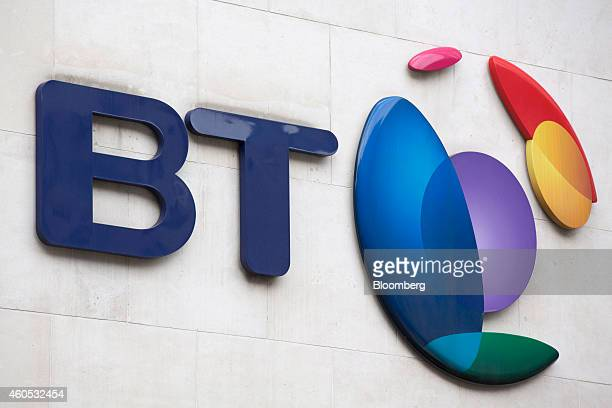 A BT logo sits on a wall outside the headquarters of BT Group Plc in London UK on Monday Dec 15 2014 BT started exclusive talks to acquire Deutsche...