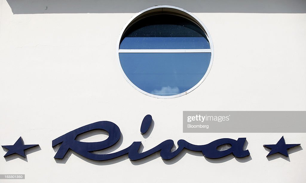 A logo sits on a wall outside the Riva shipyard in Sarnico, Italy, on Tuesday, Oct. 2, 2012. Ferretti Group, whose Riva unit made boats for Brigitte Bardot and Sean Connery, intends to open an assembly plant in China as its new Chinese parent, Shandong Heavy, seeks to drive up sales in the world's most-populous country. Photographer: Alessia Pierdomenico/Bloomberg via Getty Images
