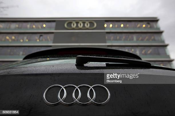 A logo sits on an Audi A6 automobile manufactured by Volkswagen AG outside the Audi AG headquarters in Ingolstadt Germany on Tuesday Feb 9 2016...