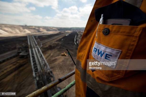 AG logo sits on an employees overalls at the Garzweiler open cast lignite mine operated by RWE AG in Garzweiler Germany on Thursday July 13 2017...