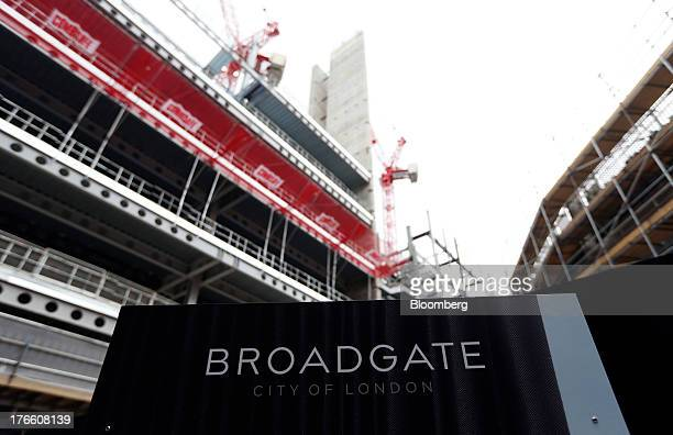 A logo sits on construction hoardings outside building site at No 5 Broadgate in London UK on Thursday Aug 15 2013 UBS AG Switzerland's biggest bank...