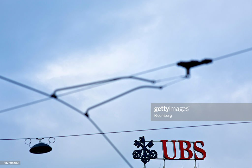 A UBS logo sits on display above the headquarters of UBS AG