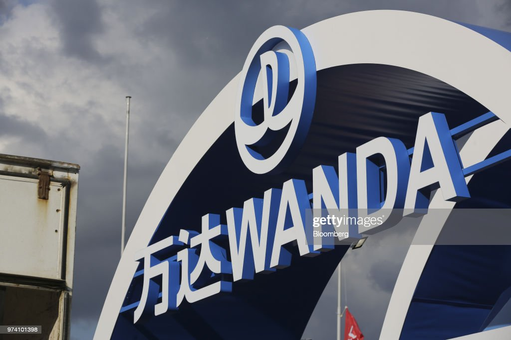 A logo sits on display at the promotional pavilion for the Dalian Wanda Group Co. during preparations ahead of the FIFA World Cup outside the Luzhniki stadium in Moscow, Russia, on Wednesday, June 13, 2018. According to an April report from the organizing committee, the total amount spent on preparations is 683 billion rubles, or about $11 billion at the current exchange rate. Photographer: Andrey Rudakov/Bloomberg via Getty Images