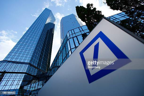 A logo sits on display in front of the Deutsche Bank AG headquarters in Frankfurt Germany on Tuesday Oct 29 2013 Deutsche Bank AG Europe's largest...