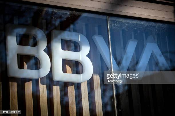 A logo sits on display in the window of a Banco Bilbao Vizcaya Argentaria SA bank branch in Barcelona Spain on Saturday March 7 2020 Spanish bank...