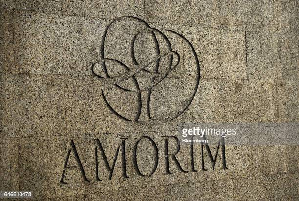 A logo sits on display on a covered cork wall outside the Corticeira Amorim SGPS SA office in Santa Maria da Feira Portugal on Thursday Feb 23 2017...