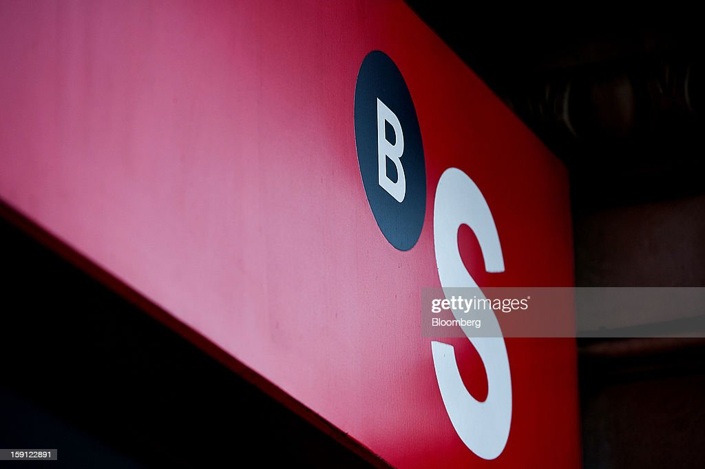 A logo sits on display outside a Banco Sabadell SA bank branch in Barcelona, Spain, on Tuesday, Jan. 8, 2013. Banco Santander SA, Spain's biggest lender, will offer 263 million euros ($345 million) in stock to buy out minority investors in its Banco Espanol de Credito SA retail unit and close 700 local branches to cut costs. Photographer: David Ramos/Bloomberg via Getty Images