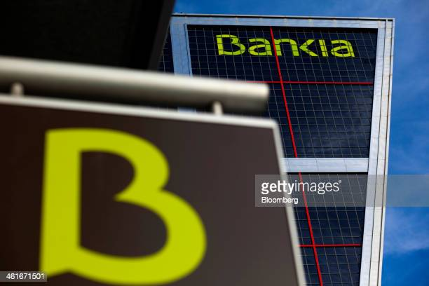 A logo sits on display outside a bank branch near the headquarters of Bankia SA in the Kio towers in Madrid Spain on Friday Jan 10 2014 Bankia SA the...