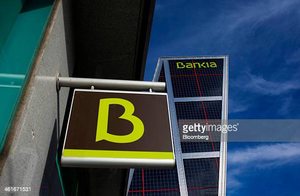 A logo sits on display outside a bank branch outside the headquarters of Bankia SA in the Kio towers in Madrid Spain on Friday Jan 10 2014 Bankia SA...