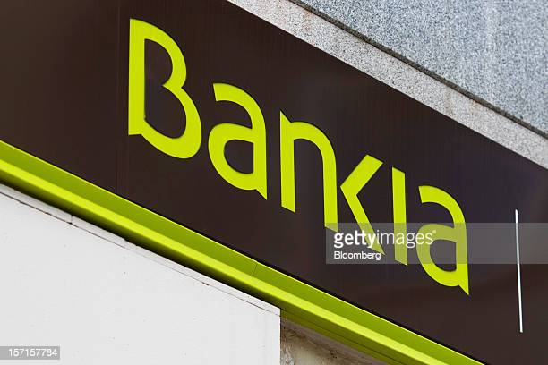 A logo sits on display outside a Bankia SA branch in Madrid Spain on Thursday Nov 29 2012 Bankia the biggest Spanish bank set to receive European...