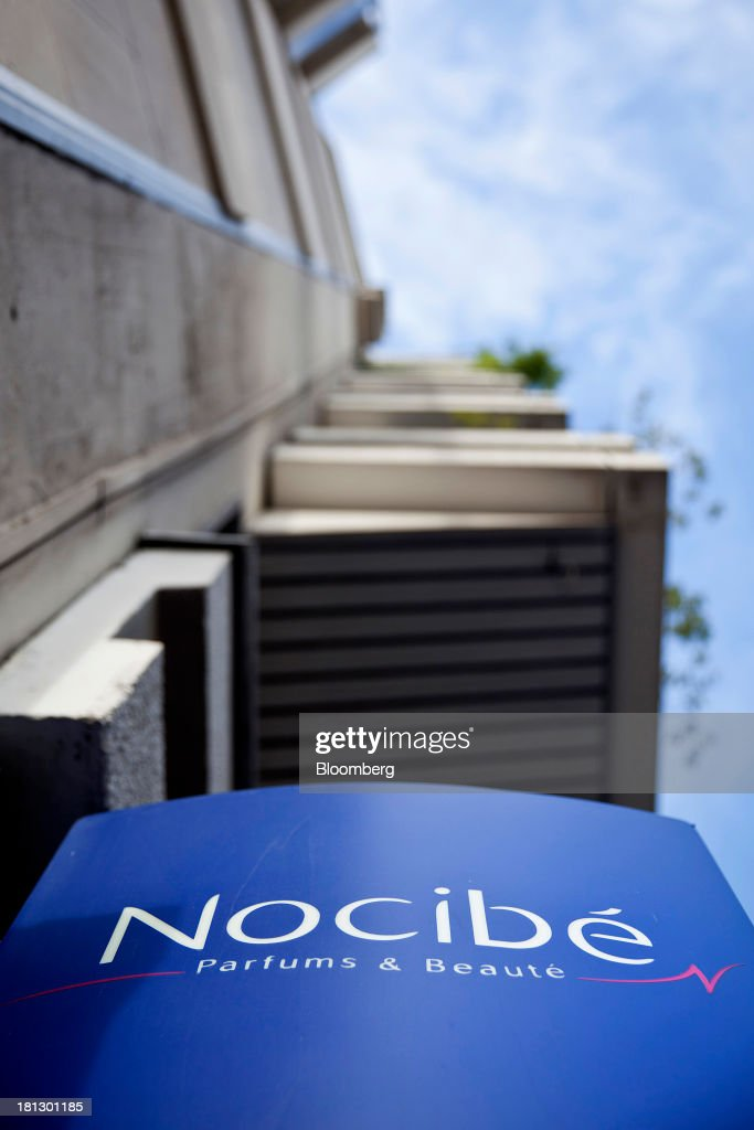 A logo sits on display outside a Nocibe SA beauty store in Paris, France, on Thursday, Sept. 19, 2013. Bank of France General Council member Bernard Maris said France will end up restructuring its debt as tax 'optimization' by large companies including Google Inc. will leave too big a burden on the middle class. Photographer: Balint Porneczi/Bloomberg via Getty Images