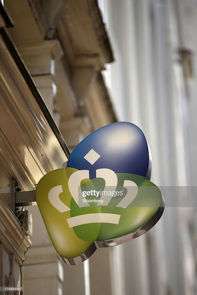 A logo sits on display outside a Royal KPN NV mobile phone store in Amsterdam, Netherlands, on Tuesday, July 23, 2013. Dutch pension funds will be allowed to calculate liabilities on the basis of an adjusted discount rate as the government seeks to keep the retirement system viable amid low interest rates and an aging population. Photographer: Matthew Lloyd/Bloomberg via Getty Images