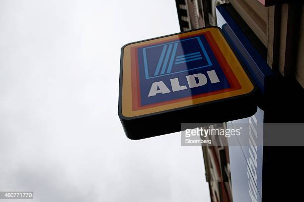 A logo sits on display outside an Aldi Stores Ltd supermarket in the Kilburn district of London UK on Monday Dec 22 2014 German discounters Aldi and...