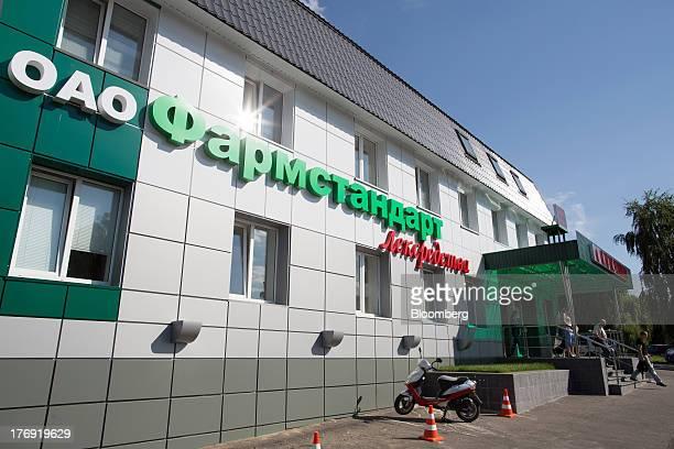 A logo sits on display outside OAO Pharmstandard's Leksredstva drug manufacturing unit in Kursk Russia on Friday Aug 16 2013 Pharmstandard said it...