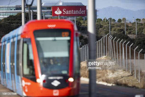 A logo sits on display outside the headquarters of Banco Santander SA beyond a tram station in Boadilla del Monte Spain on Wednesday Jan 30 2019 Were...