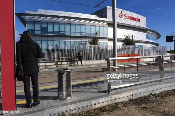 Logo sits on display outside the headquarters of Banco Santander SA beyond a tram station in Boadilla del Monte, Spain, on Wednesday, Jan. 30, 2019....