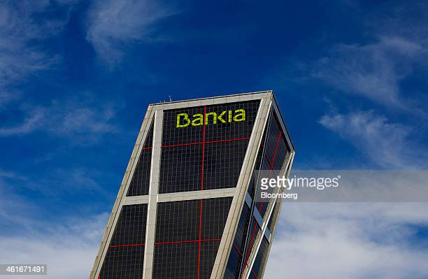 A logo sits on display outside the headquarters of Bankia SA in one of the Kio towers in Madrid Spain on Friday Jan 10 2014 Bankia SA the Spanish...