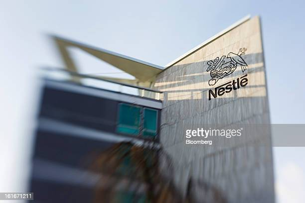 A logo sits on display outside the headquarters of Nestle SA in Vevey Switzerland on Thursday Feb 14 2013 Nestle SA said it expects 2013 to be as...