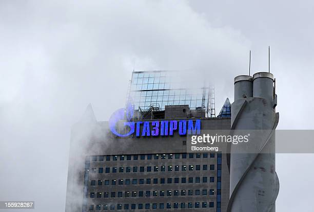 A logo sits on display outside the headquarters of OAO Gazprom in Moscow Russia on Thursday Nov 8 2012 Poland's biggest gas company is winning twice...
