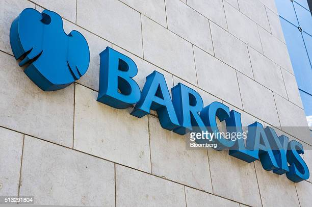 A logo sits on display outside the offices of Barclays Plc bank in Johannesburg South Africa on Wednesday March 2 2016 The South African Reserve Bank...