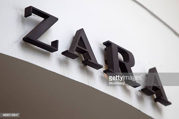 A logo sits on display outside the original Zara fashion store operated by Inditex SA which opened in 1975 in La Coruna Spain on Thursday Feb 13 2014...