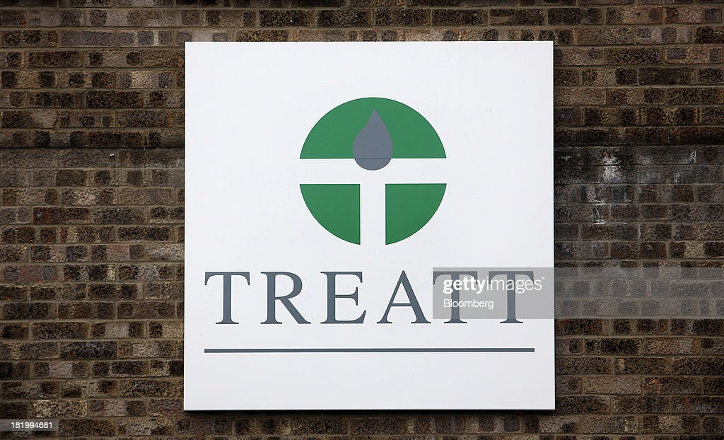 A logo sits on display outside the Treatt Plc flavoring and fragrances factory in Bury St Edmunds, U.K., on Wednesday, Sept. 25, 2013. Treatt Plc, the U.K. supplier of mango oil to the Body Shop, is considering the biggest investment splurge in its 127-year history as Chief Executive Officer Daemmon Reeve seeks to unshackle the company from family owned traditions. Photographer: Chris Ratcliffe/Bloomberg via Getty Images
