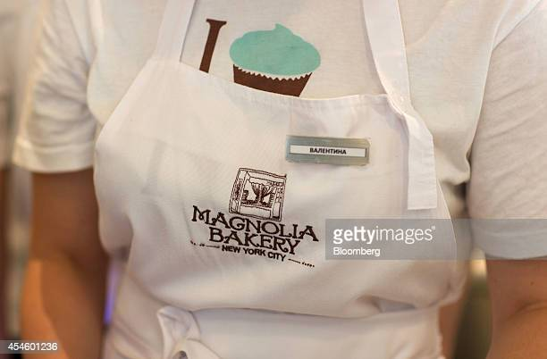 A logo sits on the apron of an employee inside the new Magnolia Bakery cake store in Moscow Russia on Thursday Sept 4 2014 Magnolia Bakery the New...