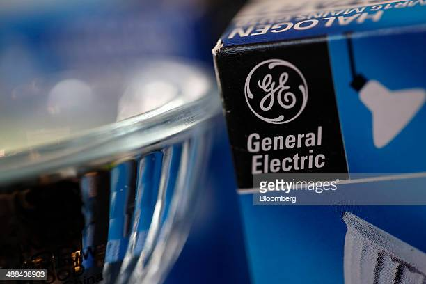 A GE logo sits on the box of a General Electric halogen lamp produced by General Electric Co in this arranged photograph taken in London UK on...