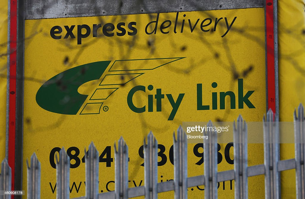 A logo sits on the cargo loading door of a delivery truck