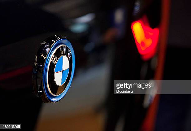 A logo sits on the exterior of a new BMW i3 batterypowered automobile manufactured by Bayerische Motoren Werke AG at the company's factory in Leipzig...