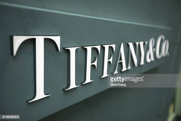 A logo sits on the exterior of a Tiffany Co luxury goods store in Frankfurt Germany on Wednesday Oct 26 2016 The world's luxurygoods market stopped...