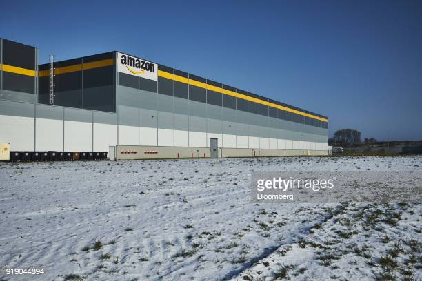 A logo sits on the exterior of Amazoncom Inc's new fulfillment center in Kolbaskowo Poland on Friday Feb 16 2018 Both academic and...