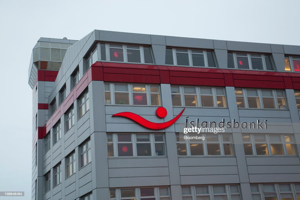 A logo sits on the exterior of the Islandsbanki hf offices in Reykjavik, Iceland, on Thursday, Jan. 3, 2013. Creditors of Iceland's three biggest failed banks are fighting for a waiver to krona controls imposed in 2008 amid risks pay-outs will be delayed beyond 2015. Photographer: Arnaldur Halldorsson/Bloomberg via Getty Images