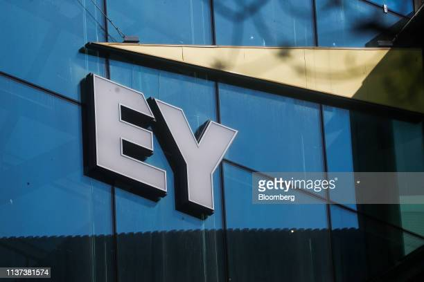 A logo sits on the offices of Ernst Young LLP stand in London UK on Monday April 15 2019 The Big Four accounting firms may have to split their...