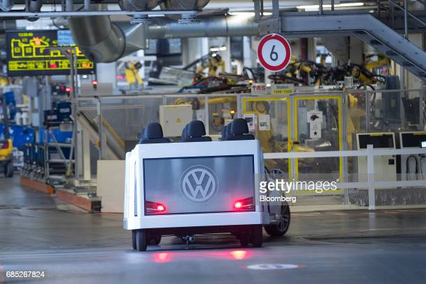 A VW logo sits on the rear of a modified Volkswagen eGolf electric automobile in the Volkswagen AG factory as part of the 'Think Blue' sustainability...