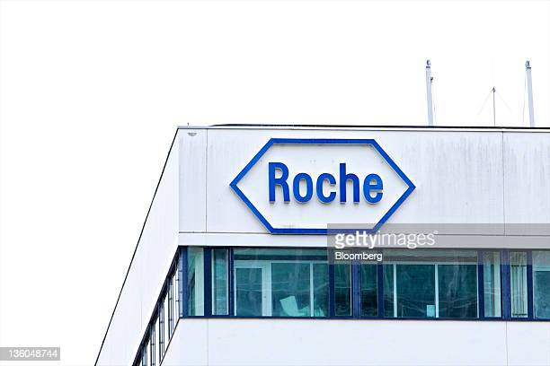 A logo sits on the side of a building at the Roche Holding AG headquarters in Basel Switzerland on Wednesday Dec 21 2011 Roche Holding AG's Zelboraf...