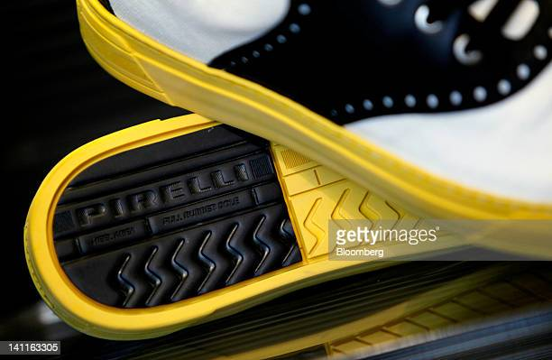 A logo sits on the sole of a Pirelli C SpA shoe displayed for sale inside the company's store in Milan Italy on Thursday March 8 2012 Rubber advanced...