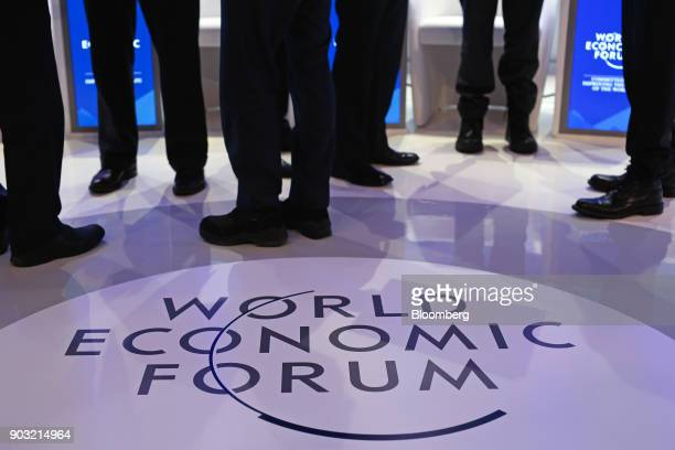 WEF logo sits on the stage as panelists talk ahead of a panel session at the World Economic Forum in Davos Switzerland on Friday Jan 22 2016...