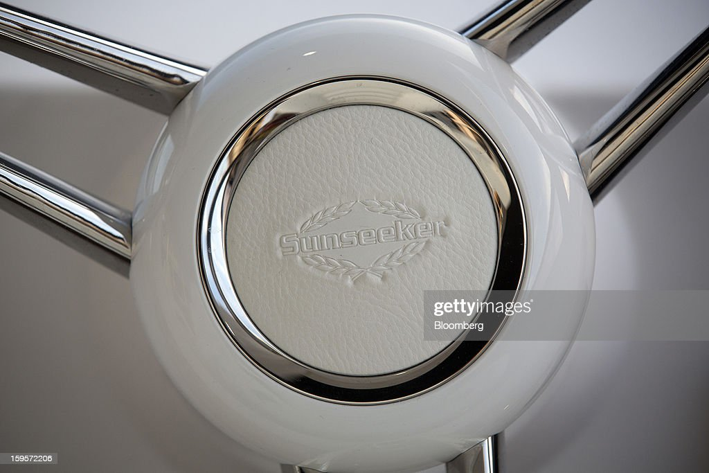 A logo sits on the steering wheel or helm of a Predator 115 luxury yacht, manufactured by Sunseeker International Ltd., during the Tullet Prebon London Boat Show 2013 at the ExCeL center in London, U.K., on Wednesday, Jan. 16, 2013. The show, Europe's first in 2013, will showcase new sailing craft from dinghies to luxury yachts, and runs Jan. 12-20. Photographer: Simon Dawson/Bloomberg via Getty Images