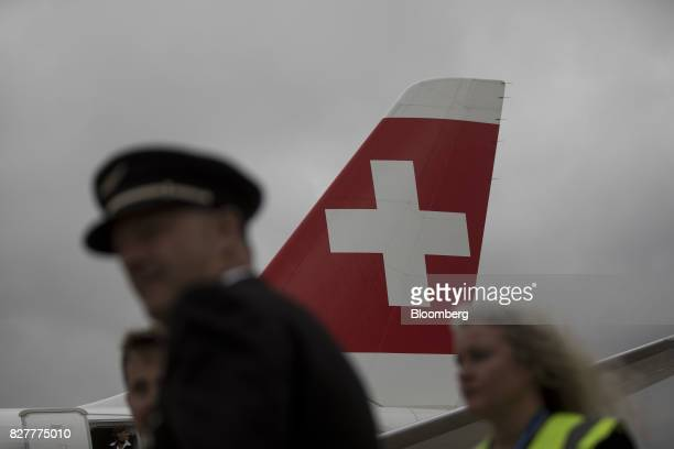 A logo sits on the tail fin of a CS100 passenger aircraft manufactured by Bombardier Inc operated by Deutsche Lufthansa AG's Swiss International unit...