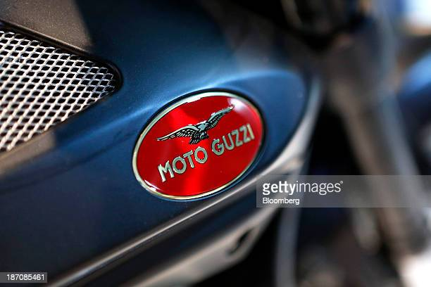 A logo sits on the tank of a Moto Guzzi V7 motorbike produced by Piaggio C SpA as it stands on display at the International Motorcycle Exhibition in...